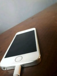 silver iPhone 5s with charger  2670 km