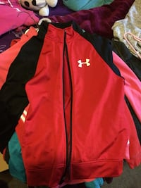 Red and black Under Armour zip-up jacket