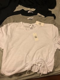 Brand new tops size medium fit xs/s as well  Surrey, V3S 3J4