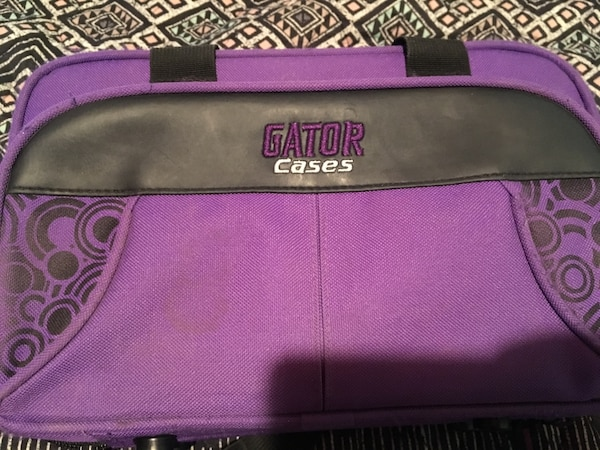 Black and purple gator cases bag and clarinet