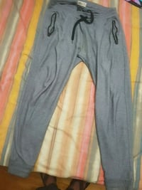 gray and black Nike track pants Montreal, H1A