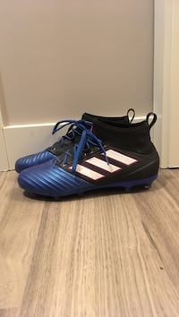 pair of blue-and-white Adidas cleats