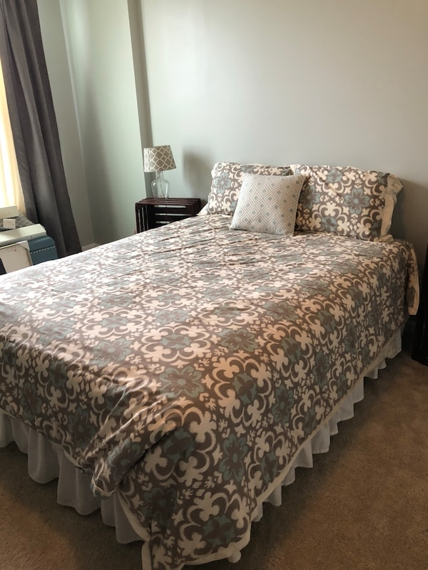 Queen sized duvet with alternative down comforter. Comes with two matching pillow shams and decorative pillow