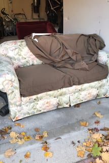 Love seat with brown slip cover