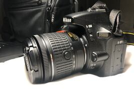 Nikon D5600 DSLR camera with 18-55 mm lens
