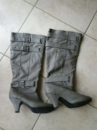 pair of gray leather 3-buckle chunky heel riding boots