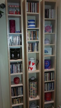 3 tall thin shelving units with 12 adjustable shelves