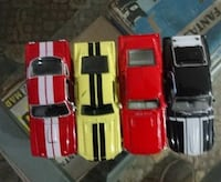 four assorted diecast cars