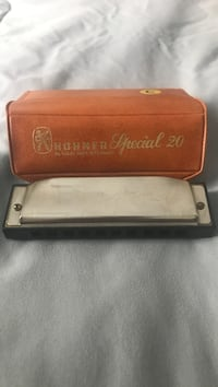 Harmonica with leather case  Rocky Mount, 27803