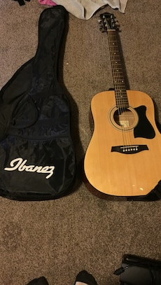 brown Ibanez classic guitar with bag