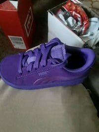 pair of purple puma low-top sneakers Champaign, 61821