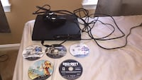 black Sony PS3 slim console with game cases Ashburn, 20147