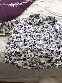 white and black floral scoop-neck shirt
