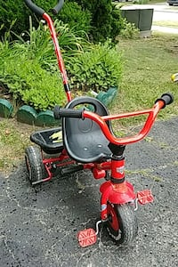red and black Radio Flyer trike  Oakville, L6M 3B9