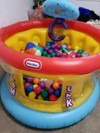 baby's yellow and red Little Tikes ball pit with o Edmonton, T6W 2C3