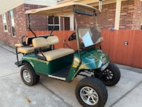 EZGO lifted golf cart