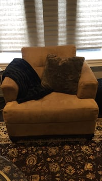 Brown fabric sofa chair with throw pillows