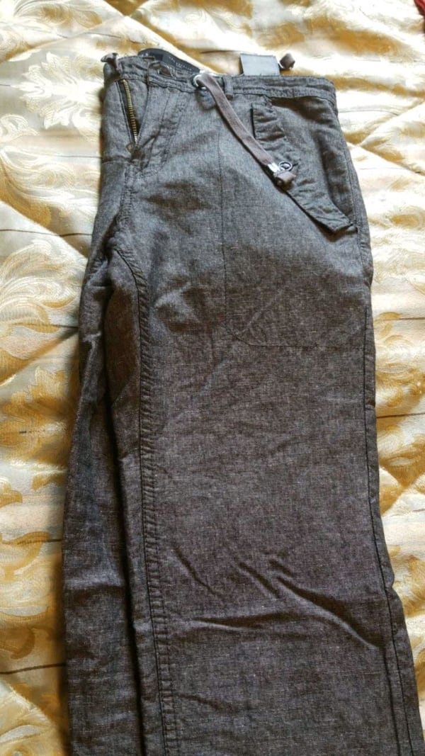 Guess pants mens size 29 but could fit waist 30 and new  dd50d37f-b354-4987-b83c-f9c369071ada