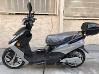 black and gray motor scooter 2272 mi