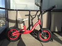 toddler's red and black bicycle Бёрнаби, V5E 1B9