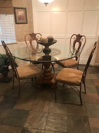 Round Glass with wood pedestal. 4 wood & wrought iron chairs.  Houston, 77015