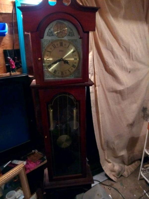 brown wooden grandfather clock