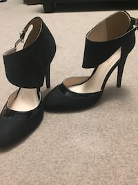 Pair of black leather peep toe ankle strap pumps