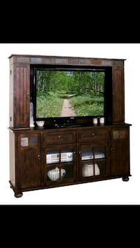 brown wooden TV hutch with flat screen television Vidor, 77662