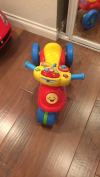 red, yellow, and blue Vtech tricycle ride-on toy Buena Park, 90620