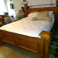brown wooden bed frame with white mattress Arlington, 76015