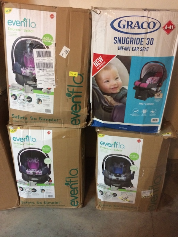 Four Evenflo and Graco boxes