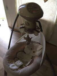 Baby's gray and white cradle and swing Gibsonton, 33534