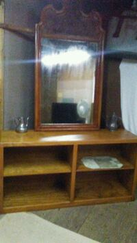 brown wooden TV hutch with flat screen television null