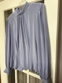 Orchid blouse. Size 16. Runs small.  More like14. Hagerstown, 21742