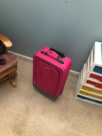 Pink suitcase and black laptop bag Leesburg