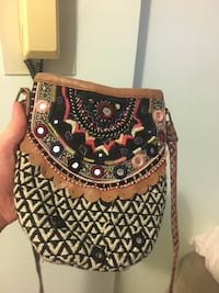 Multi-colored satchel purse. Not super big, but can fit a wallet and phone. New York, 10021