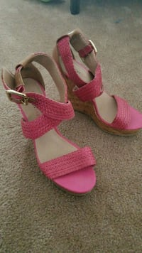 pair of pink-and-brown wedge sandals