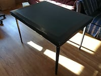 Table with foldable legs