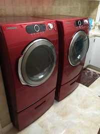 Red front-load clothes washer and dryer set Montréal, H1S