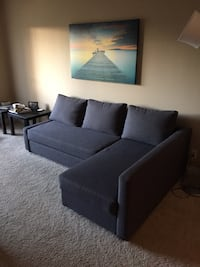 Black fabric sectional sofa or couch with pull out bed