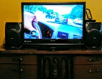 black flat screen TV with brown wooden TV stand Baltimore, 21215