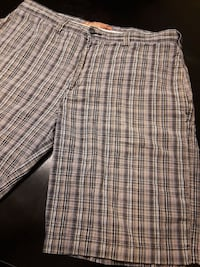 black, brown, and white plaid shorts