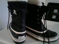 pair of black-and-white Sorel duck boots Montréal, H3S 1H9