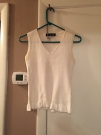 Cream colored sleeveless top with ruffles that are brand name J.A.C. Nashville, 37221
