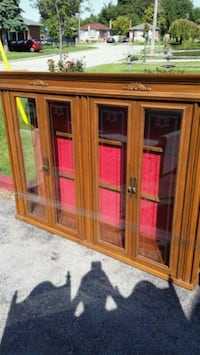 brown wooden framed glass display cabinet Toronto, M1J 1L3