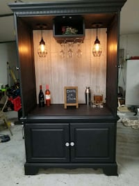 black wooden 4-door cabinet Auburndale, 33823