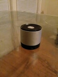 black and gray bluetooth speaker