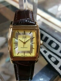 square gold analog watch with black leather strap Mayfield Heights, 44124