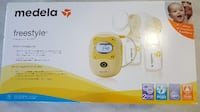 white and yellow Medela electric breast pump box Toronto