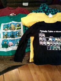 two black and green crew-neck shirts 997 mi